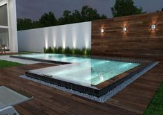 Backyard swimming pool with wooden decking and white pebbles Hinterhof-Swimmingpool mit Holzterrasse