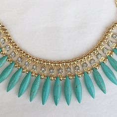 Blue/turquoise feather-like statement necklace Super cute statement necklace with marbled feather-like beads. Fashion jewelry, with cute rhinestone accents. Looks great with a solid shirt to really make this piece pop! ❤️Multiple in stock, please request a new listing for purchase!❤️ Jewelry Necklaces