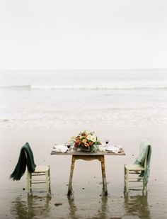 engagement shoot. toes in the sand; feet in the ocean, complete with blankets & shabby chic details.