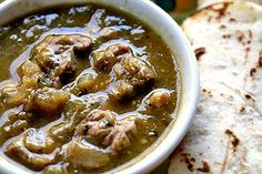 Mexican pork chile verde recipe, with chunks of pork shoulder slow cooked in a roasted tomatillo and jalapeno chile verde sauce.