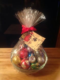 I am so excited about this one of a kind gift basket.  It is a vintage glass bowl on a sterling silver stand filled with original vintage Christmas ornaments. So fun & quite colorful !