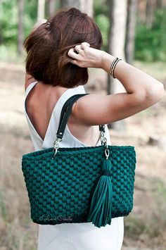 Big bag with eco- leather handles. Crocheting by hand from tshirt yarn. Composition cotton 100%. The size of the bag is 16*10.9*6.2 in/ 41*28*16 cm The size of the chain is 15.6 in/ 40 cm You can choose the color of the bag in a palette of 45 shades. Stylish and comfortable