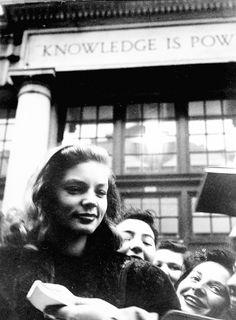 Bacall. Among the crowd.