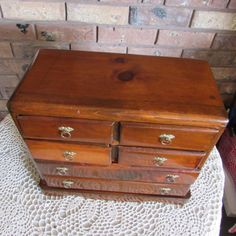 Hand made wood jewelry box Maine State Prison. Real thick beautiful wood with knots, not your normal production jewelry box. Does have some marks and dings but not that noticeable. I waxed it with Old English furniture polish and looks nice. On the bottom says Maine State Prison.  The inside is just some type of cloth not the normal felt type, should be easy to redo. Nice collectible item. Has two large drawers and four smaller ones.  12 1/2 wide 10 1/2 tall 6 1/2 deep  I have ...