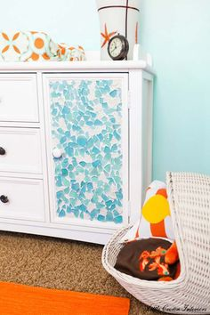 A Dresser decorated with sea glass:  24 Cute DIY Home Decor Ideas With Colored Glass and Sea Glass