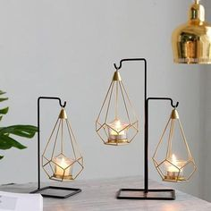 Decorate your home, office or restaurant in luxurious modern Nordic decor with a stunning hanging cage candle holder! Made from premium metal. Available in a range of sizes - sold individually. Free Worldwide Shipping & Money-Back Guarantee Hanging Candles, Hanging Lights, Hanging Candle Holders, Modern Candle Holders, Hanging Lamps, Tea Light Candles, Tea Lights, Candle Lamp, Candle Stand