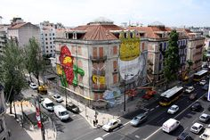 The Crono Project is creating street art on a massive scale. This corner building shows work by Os Gêmeos and Blu | Lisbon