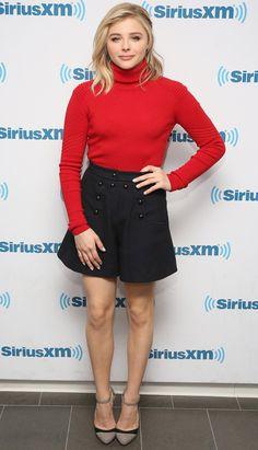 Chloe Grace Moretz in a red turtleneck, mini skirt and heels