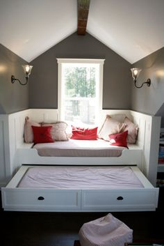 Treat a window seat like its own little room with panelling and light fixtures. This window seat obviously moonlights as a guest bedroom with a trundle bed and pillows that are part and parcel of the bedding. Decor, House, Small Spaces, Home Projects, Home, Cool Bunk Beds, Bedroom Design, Attic Bedroom Designs, Built In Bed