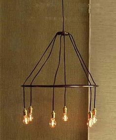 Noticed recently: appealing modern—yet simultaneously medieval—halo chandeliers, with wood, iron, stainless, and even chainmail components. Abo