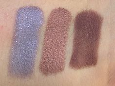 Swatches of Candied Violet, Amaretto, Cherry Cordial from the Too Faced Chocolate Bar eye palette.