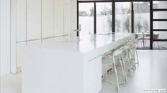 Focus your kitchen on a view. Corian Glacier White