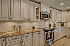 white cabinets with Antique Mascarello counter top - Google Search-my inspiration for our kitchen! Even has subway tiles as backsplash! Not doing glaze on cabinets but I should get close!