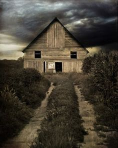 Old barn with windows and door resembling eyes and mouth..