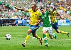 Andreas Granqvist of Sweden and Wes Hoolahan of Republic of Ireland compete for the ball during the UEFA EURO 2016 Group E match between Republic of Ireland and Sweden at Stade de France on June 13, 2016 in Paris, France.