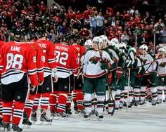 Zach Parise #11 of the Minnesota Wild leads the team in handshakes with the Chicago Blackhawks after the Blackhawks won the series with a 5-1 victory in Game Five of the Western Conference Quarterfinals during the 2013 Stanley Cup Playoffs at the United Center http://www.fansedge.com/Chicago-Blackhawks-vs-Minnesota-Wild-in-Conference-Quarterfinals-Game-5-on-592013-_106801518_PD.html?social=pinterest_pfid77-36301