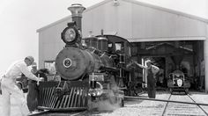 Engineers inspect Disneyland Railroad engine number 2 at a maintenance facility