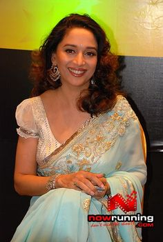 Madhuri Dixit in powder blue sari with gold and bead embroidery
