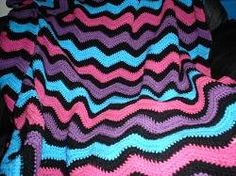 ripple afghan on a chilly night is the best thing next to making it. We all remember the colorful afghan thrown across the back of the sofa. Well I have included a free pattern