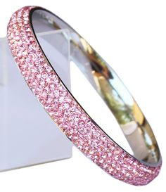 Bangle: with 5 Rows of Beautiful Sparkly Crystals - Baby Pink - Stackable. Stainless-Steel. Matching Earrings and Pendant available. To find the matching earrings set, type the Color you are interested in into the Sophistikitty search. Extra stunning when stacked with multiple bangles.