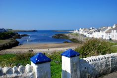 The pretty village of Portnahaven on the Isle of Islay  http://www.islaypictures.com/images/portnahaven-may-2008.jpg