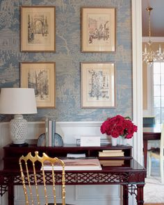 Instead of grey walls, this is a light blue, but it has gold and dark wood tones. The pictures on the wall are also reminiscent of sepia photographs. Also love the pop of red with this color scheme.