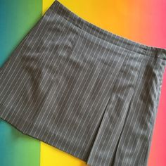Isaac Mizrahi skirt  HP 5/23 Isaac Mizrahi pleated pin stripe skirt. Part of the the Isaac Mizrahi collection for Target. Lays perfect. Looks like new. Excellent condition. Waist 17 3/4. Hips 22 1/4. Length 18 inches. Size 14 or size 12. Izaac Mizrahi Skirts