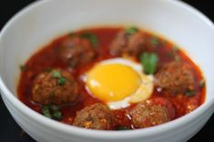 """Moroccan Meatball and Egg Tagine - """"For breakfast or dinner, a meatball tagine hits the spot. Warmly spiced tomato sauce and meatballs are simmered together then topped with runny baked eggs that give the dish a creamy texture. Primal Recipes, Beef Recipes, Whole Food Recipes, Cooking Recipes, Healthy Recipes, Soup Recipes, Primal Blueprint Meal Plan, Moroccan Meatballs, Moroccan Dishes"""