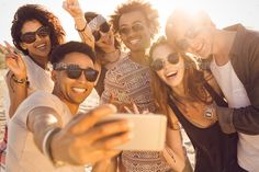 Group of multiracial happy friends taking selfie and having fun by vadymvdrobot. Group of multiracial happy friends taking selfie and having fun on a beach Selfie, Technology Photos, Group Photography, Happy Photography, Happy Friends, Schneider, Lightroom Presets, Family Photos, Have Fun