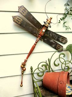 porch post, fan blades, glass drawer pulls, all repurposed to make this fancy creature... Savvy Salvage @ the Shops of Baileywick