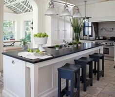 Makeover: A Kitchen Reno With Country Details Sophisticated white kitchen with black counters from Canadian House and Home – lime green and blue painted stools are great accents. Kitchen Reno, New Kitchen, Kitchen Dining, Kitchen Remodel, Kitchen Islands, Long Kitchen, Kitchen Ideas, Kitchen Floor, Kitchen Designs