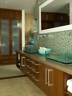 I love these dual sinks. I really like modern style and these sinks really play off of the tile very well.