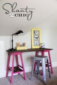 Bar stools used to make a desk, like trestles. Shanty 2 Chic.