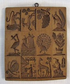 Antique wooden Springerle cookie mold board, animals, people and food. Lion, impala, grape cluster, squirrel, stork with a baby, ship, peacock, flower, butterfly, woman cooking in kitchen, giraffe and boy/elf reading Chip Carving, Wood Carving, Decorative Trunks, Springerle Cookies, Butter Molds, Food Lion, Cookie Press, Rolling Pins, Antiques Online