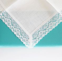 Personalize a fine lace handkerchief with a monogram.