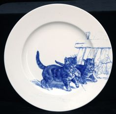 One of twelve circular plates, each decorated with a different image of cats. Kingston Lacy © National Trust / Simon Harris. two naughty kittens