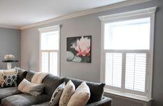 Light gray walls, dark gray couch. I like the molding on the windows.