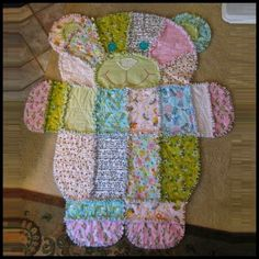 Turn old baby clothes into a teddy bear quilt.