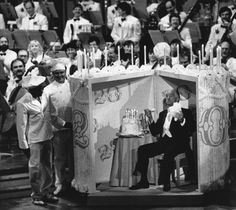 Victor Borge emerging from a giant cake, eating cake (no piano)