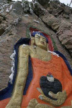 Buddha image carved into a mountainside