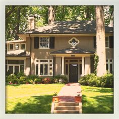 Love love love all the huge trees, black shutters and white trim. One day!!