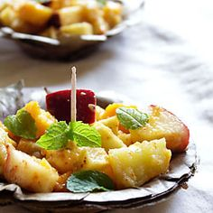 fruit chaat: mixed seasonal fruits with boiled sweet potatoes & fried potatoes, spiced with indian spices - tangy north indian street food