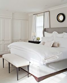 love the simplicity of this white bedroom.