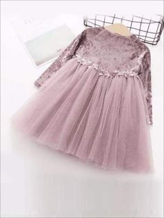 For your trendy little one, this velvet long sleeve tutu dress will be just perfect, complete with matching dainty lace waist accent. Order 1 size up Poly/Spandex Hand wash cold water, hang dry Imported: This item ships from our overseas fulfillment center. Please allow 14-21 days for Delivery. Once you see it you wi