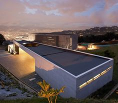 Completed in 2009 in Medellin, Colombia. Images by Sergio Gómez, Edgar Domínguez, Juan Felipe Gómez Tobón, Andrés Felipe Mesa Trujillo. Between pations, thresholds and views This house is located in a sloped zone and has 3 different levels all viewing towards the city in a...