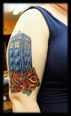 TARDIS tattoo. I am a HUGE fan of Doctor Who, I seen this tattoo and it kicks butt.