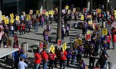 Demonstrators participate in a Fight for $15 wage protest at San Diego's international airport in California Tuesday.