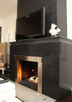 I don't really care for *this* fireplace, but it reminds me that I want one in the family room. Cozy!