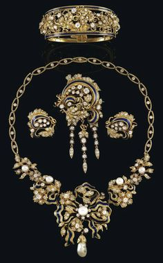A pearl and diamond parure,  gold 750, some enamelling, natural- and cultured pearls, old-cut brilliants and -diamonds, total weight ca. 10 ct consisting of: bangle, necklace, length: ca. 42 cm, socket fastenings, brooch, 2 ear rings, partly detachable, French duty hallmark, workmanship mid-19th cent.