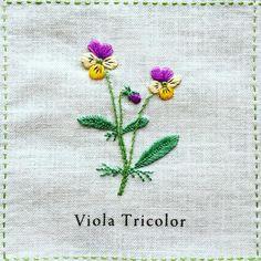 2016.07.13 wed + Viola Tricolor「ビオラ」 + このビオラは、花びら一枚一枚のサテンステッチの糸の運びに気をつけてみました。 面を埋めつつ花の中心に向かって刺していくことで、より立体的に見えるかな、と。 + #刺繍 #青木和子 #庭図鑑のモチーフクロス #ホビーラホビーレ